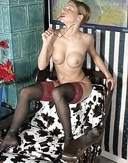 Mature business lady exposes her huge heavy rack