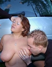 Horny chubby MILF sucking cocks in a car