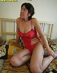 Horny mature slut playing with her cunt