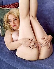 Blonde grannie having fun with her holes