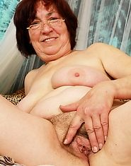 Granny lets her young lover fuck her pussy with a dildo and his cock