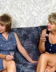 Two drunken mature ladies are doing a youngster