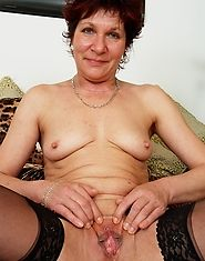 Hot grandma in stockings gets a fucking from a young stud