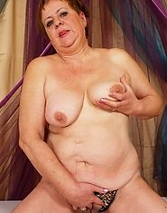 Big titty granny plays with a hard cock in front of her