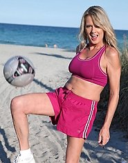 Athletic soccer mom shows off her tight body under the summer sun