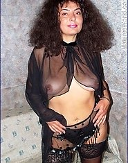 Mature strips in black lingerie