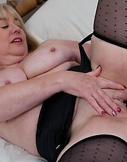 Big breasted mature slut giving one hell of a show