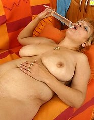 Plump granny plays with truly enormous glass dildo